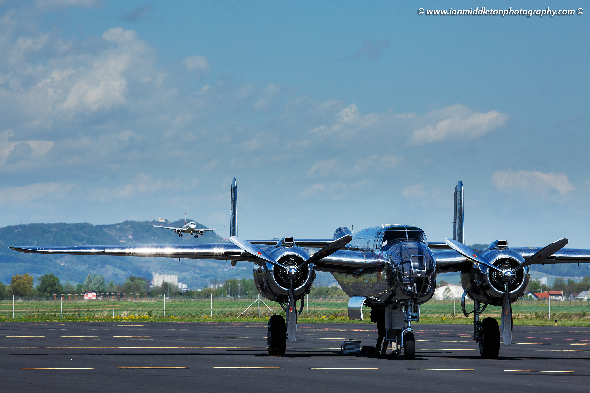 Bomber at the Red Bull open day at Maribor Edvard Rusjan Airport, Slovenia. Austria Airlines is landing in the background