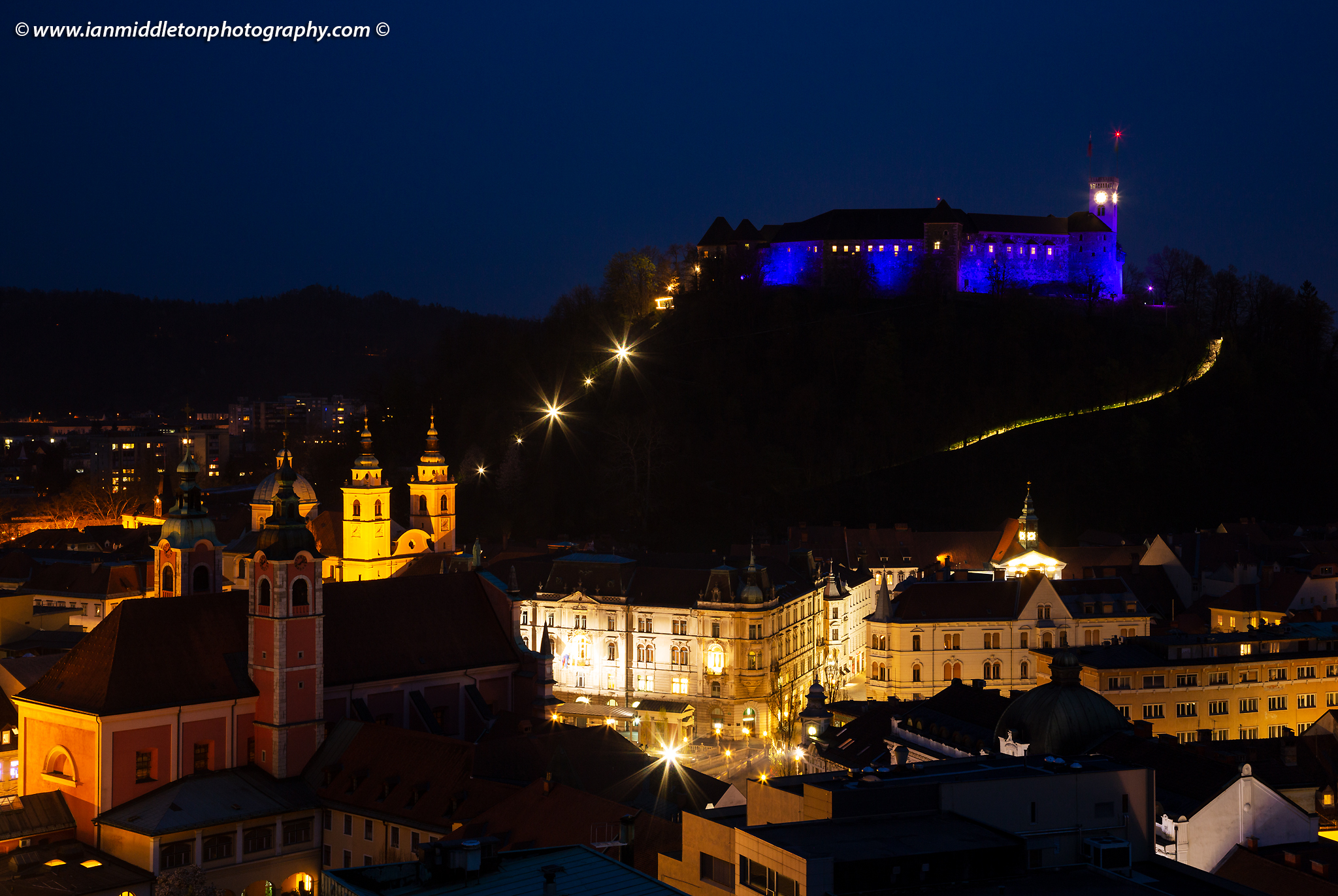 View over Ljubljana centre to the Ljubljana Castle lit up blue for Autism Awareness Day 2019 Slovenia