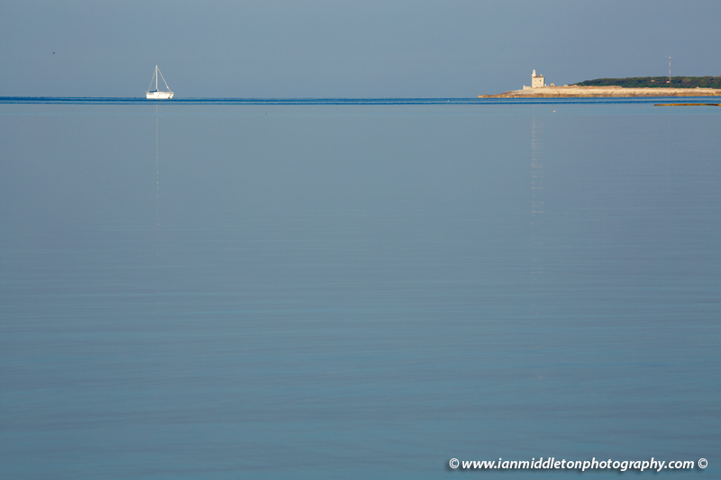 Lighthouse at the southern end of Veli Brijuni Island, Croatia. Seen from Puntižela Beach, Štinjan north of Pula.