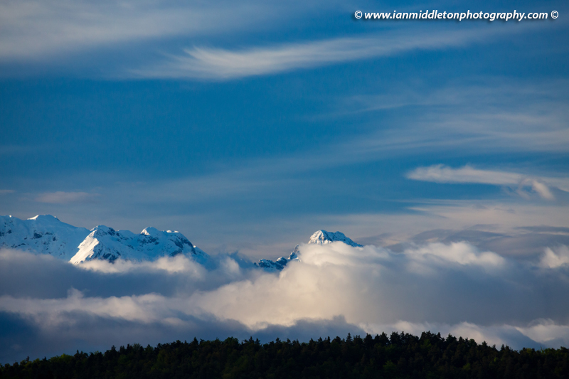 Rain clouds clearing over the Kamnik Alps after a day of heavy rain. On the higher ground they brought snow.