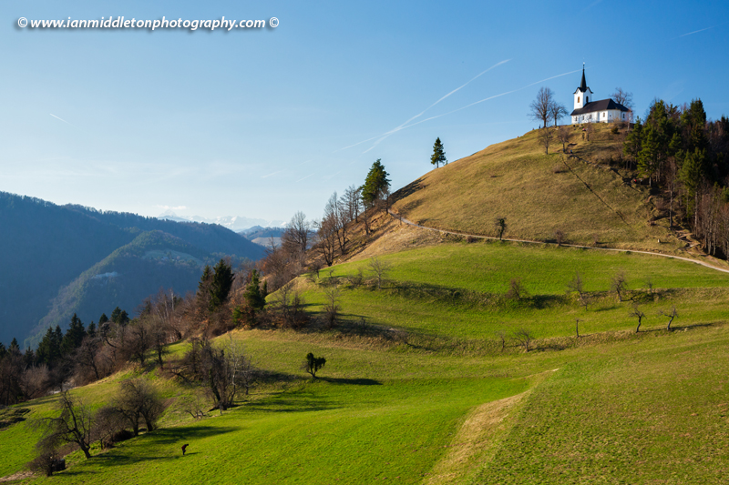 The church of Saint Jacob (Sveti Jakob) near Medvode, Slovenia. Situated on a hilltop in the Polhov Gradec Hill Range. This is also a popular hiking spot for locals.