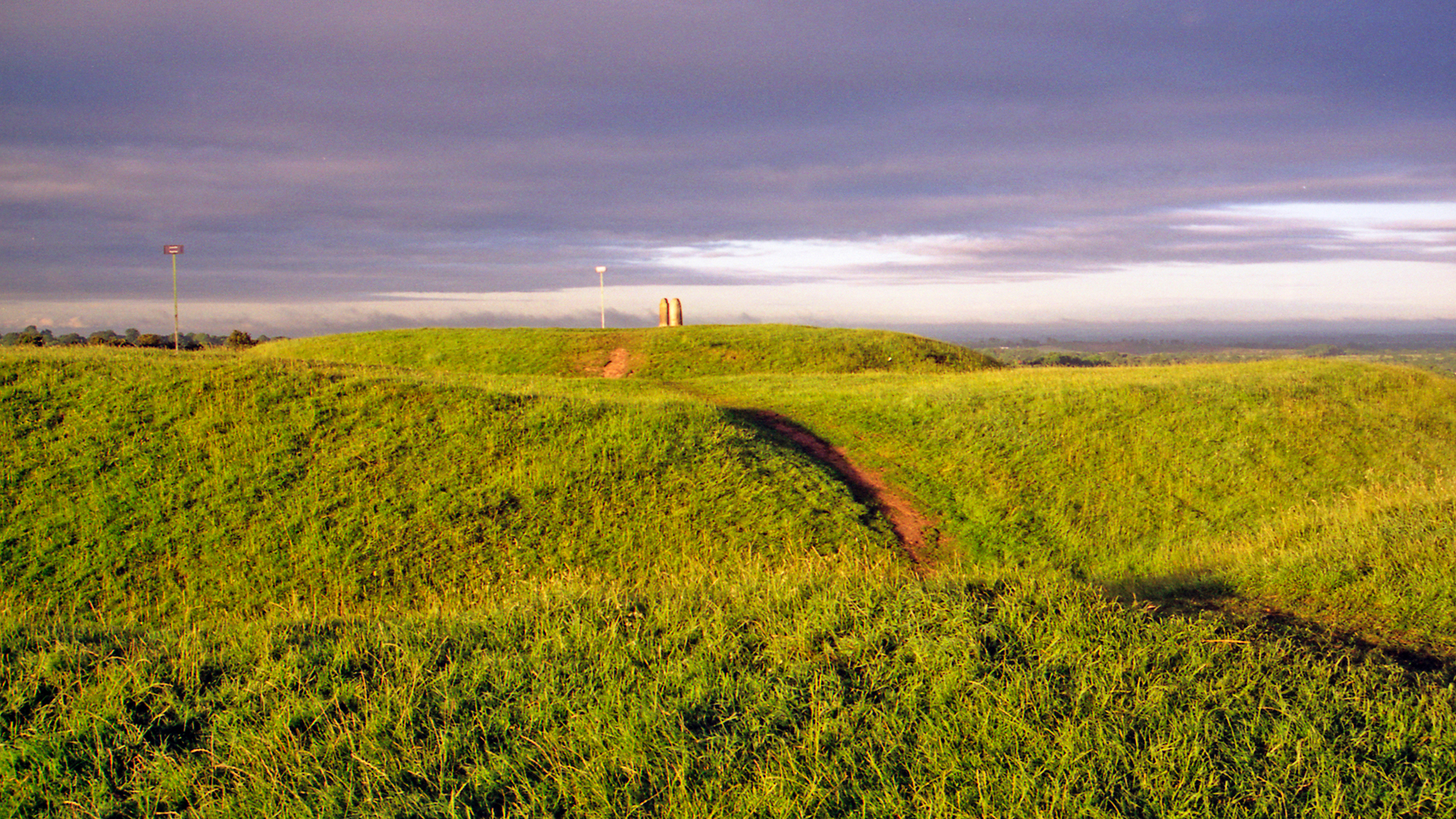 Iron age rath at the Hill of Tara in County Meath, Ireland. Tara was once the ancient capital of Ireland, from where the high king ruled over the country. The upright stone you see on the mound is the Lia Fail (stone of destiny). According to Celtic legend the Lia Fail was used during the coronation of the high king, and was believe to emit a roar when the true high king touched it. (I tried but there was no sound, so I crossed being high king of Ireland off my list of potential destinies).